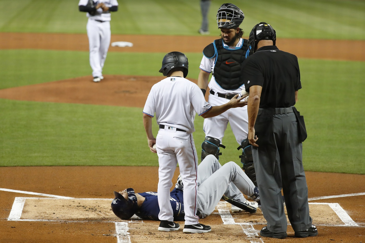 Yelich out six weeks, doesn't need surgery; Braun wearing his jersey