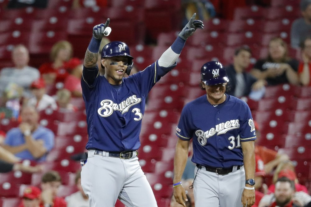 LEADING OFF: Brewers, Twins on brink of some bubbly