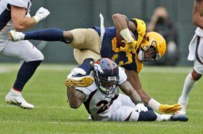 Packers Aaron Jones v Broncos AP