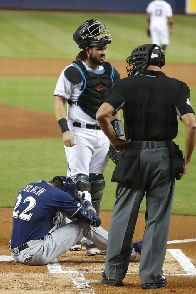 UPDATE: Brewers star Yelich breaks kneecap on foul, out for season
