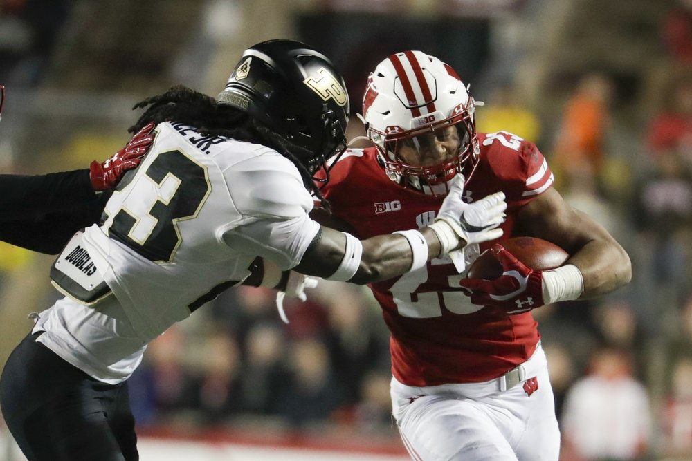 With 222 yards, Taylor breaks another record as No. 14 Badgers beat Purdue