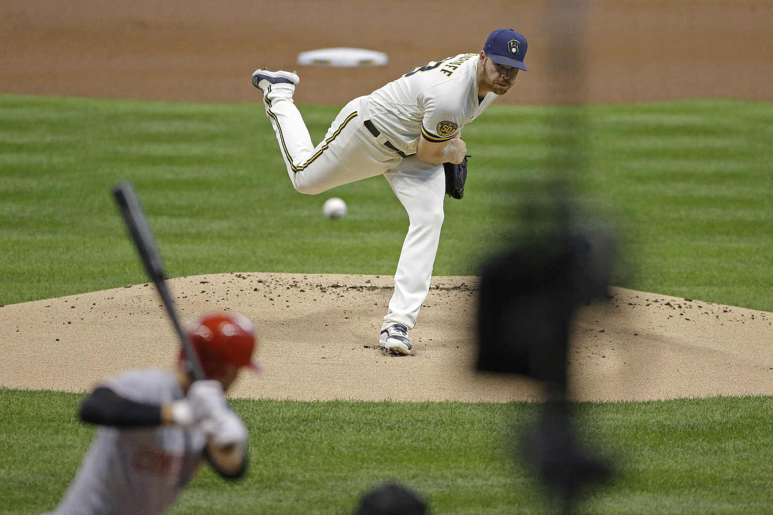 Woodruff leads Brewers to 3-2 win over Reds
