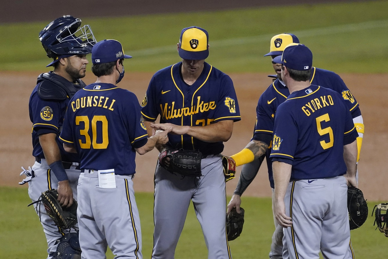 Four 1st-inning walks spot Dodgers two in Brewers Game 1 loss