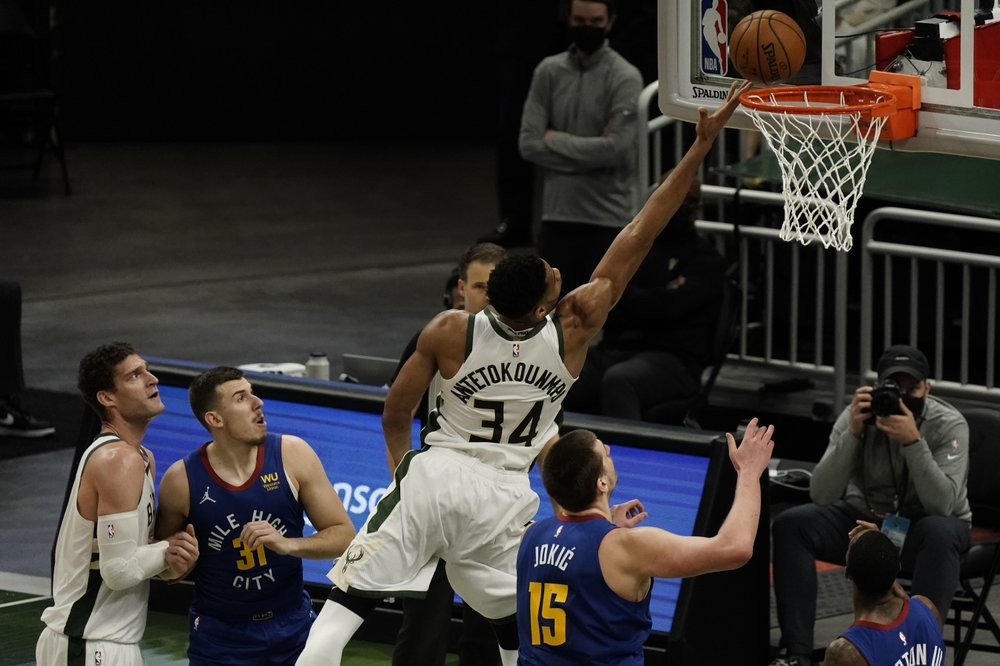 Jokic's triple-double leads Nuggets to 128-97 rout of Bucks