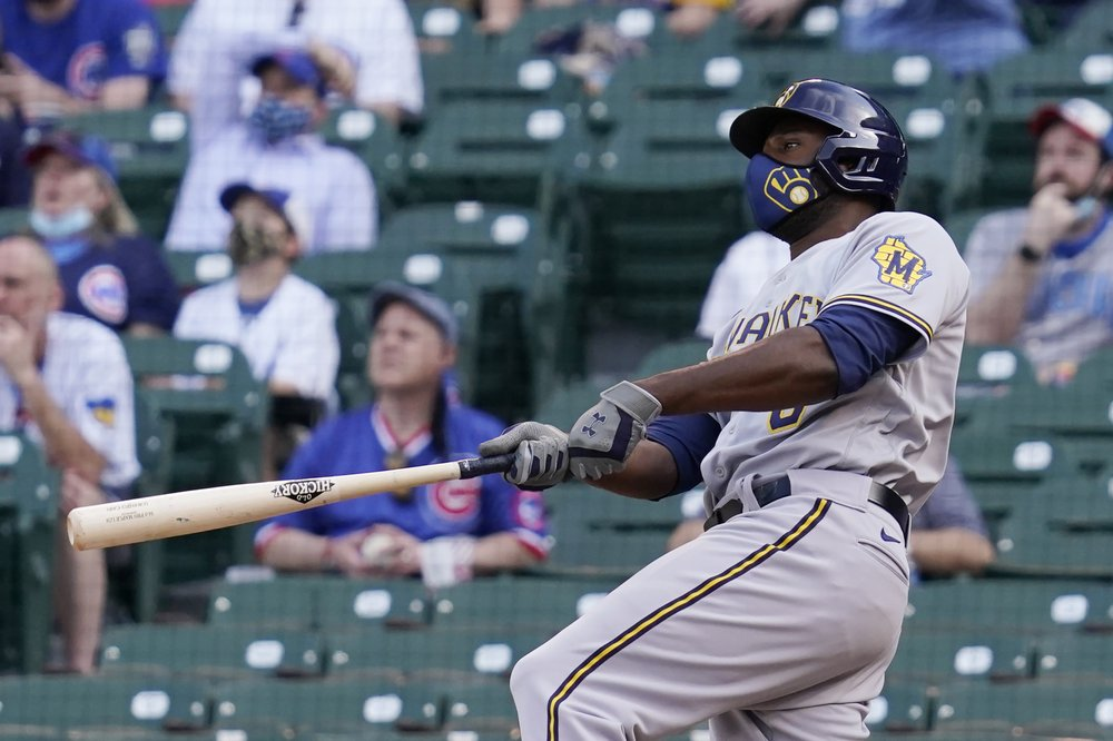 Cain 2 HRs, Woodruff sharp, Brewers beat Cubs win in extras, take 2 of 3 in series