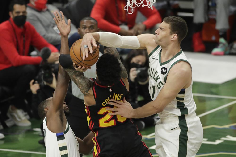 Bucks begin their title defense after abbreviated offseason
