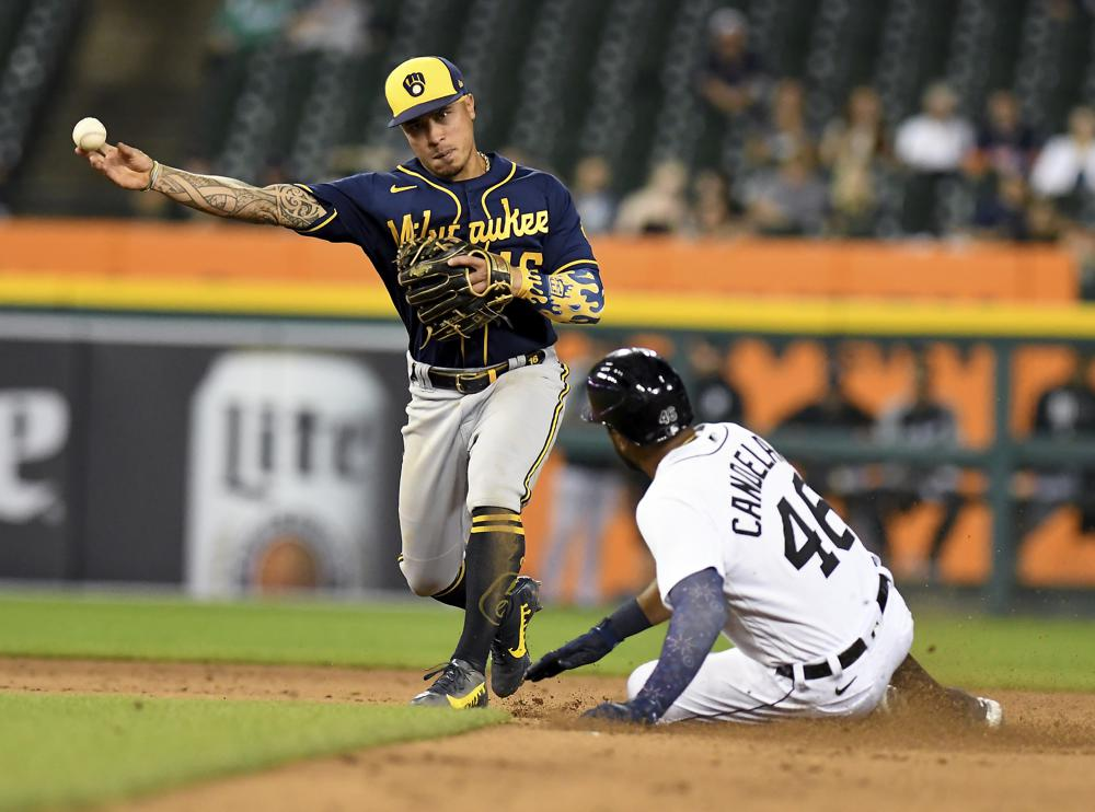 Hill hits game-winning double in 11th, as Tigers end Brewers' win streak