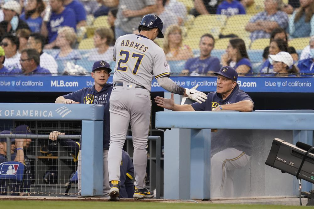 Urías wins 20th, LA beats Brewers 8-3 to stay alive in West